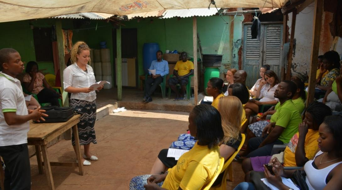 Projects Abroad representatives address a community on police brutality on their Human Rights internships in Ghana.